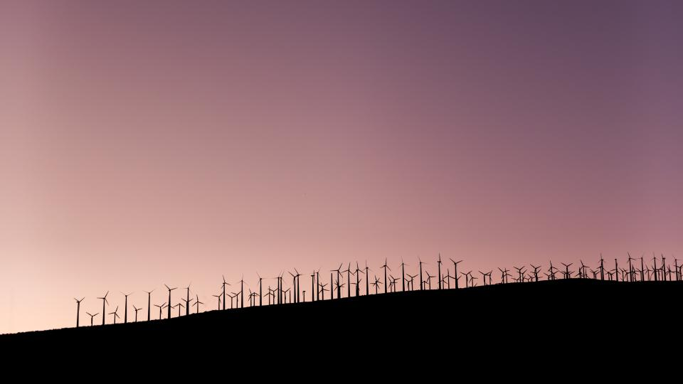 windmill field farm solar energy mountain highland landscape sky sunset silhouette