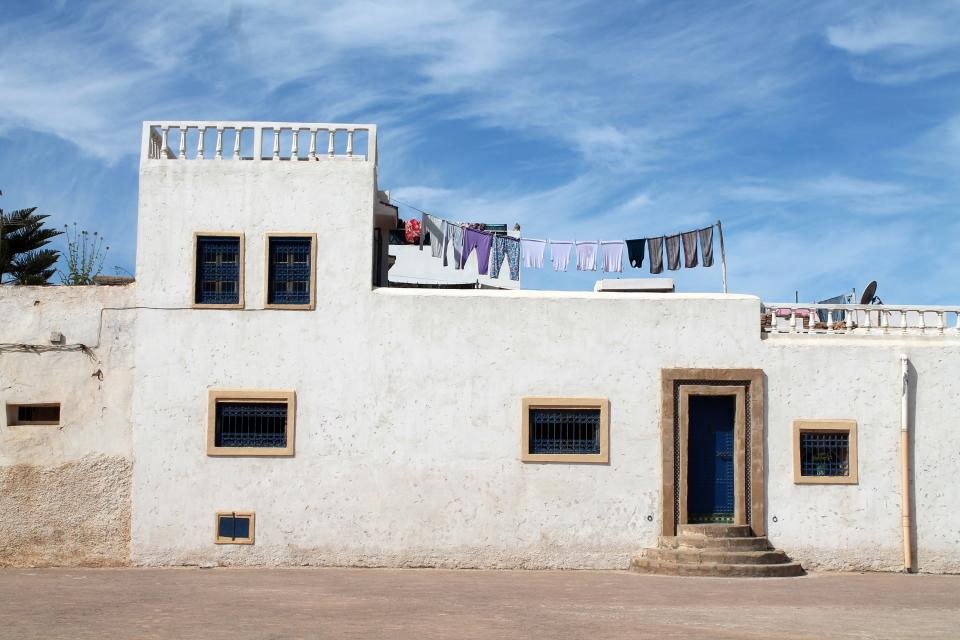 architecture building house structure laundry rooftop cloud sky sunny day