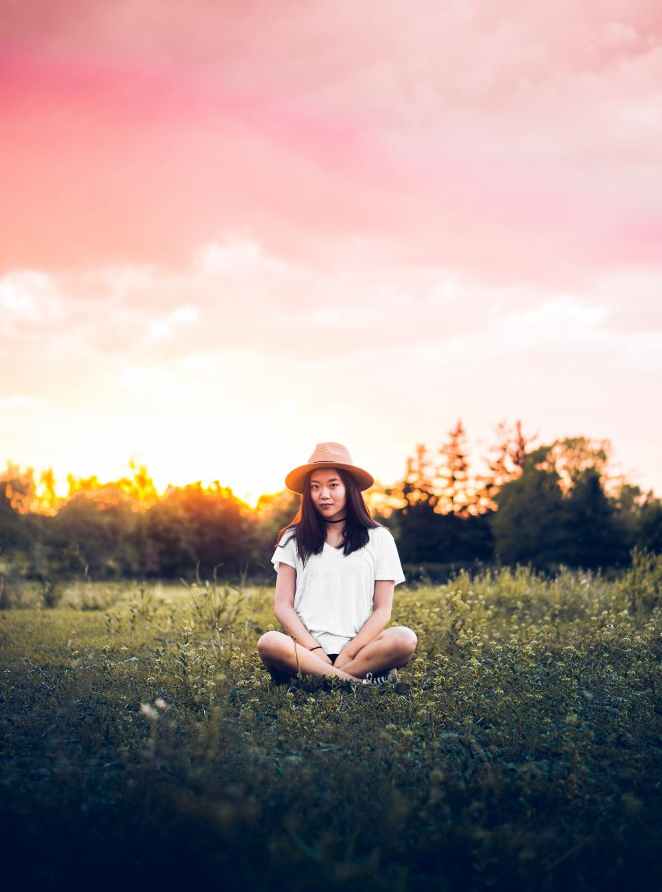 green grass grassland outdoor people girl sitting alone nature sunset sky cloud