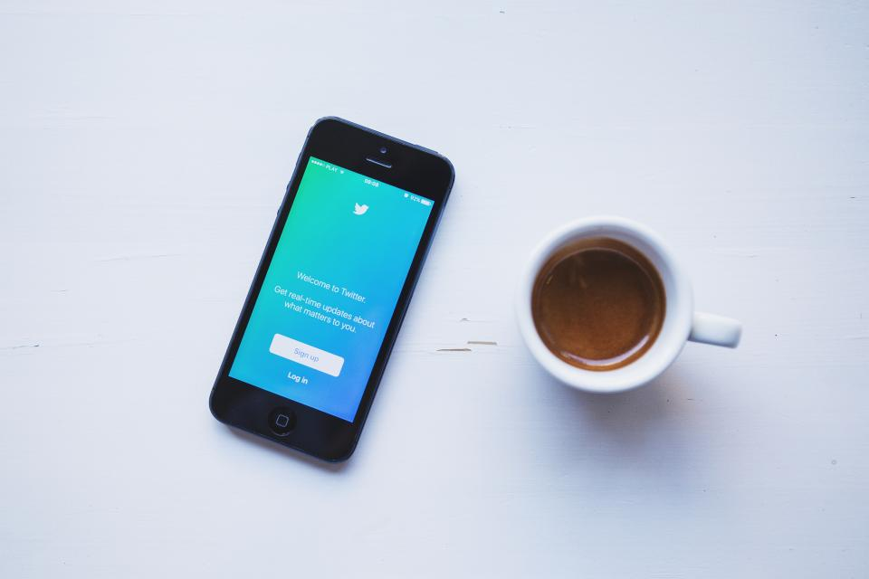 twitter social media business iphone mobile smartphone espresso coffee desk