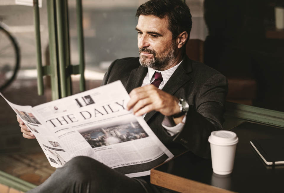 boss break business businessman cafe caucasian ceo coffee coffee cup coffee shop cup daily news economy latest mature morning news newspaper person politics reading relaxing resting routine sidewalk cafe sitting smiling strategy