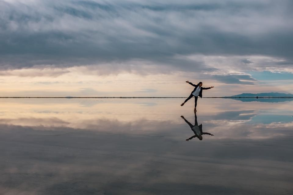 people woman alone sea water beach reflection sky nature clouds horizon