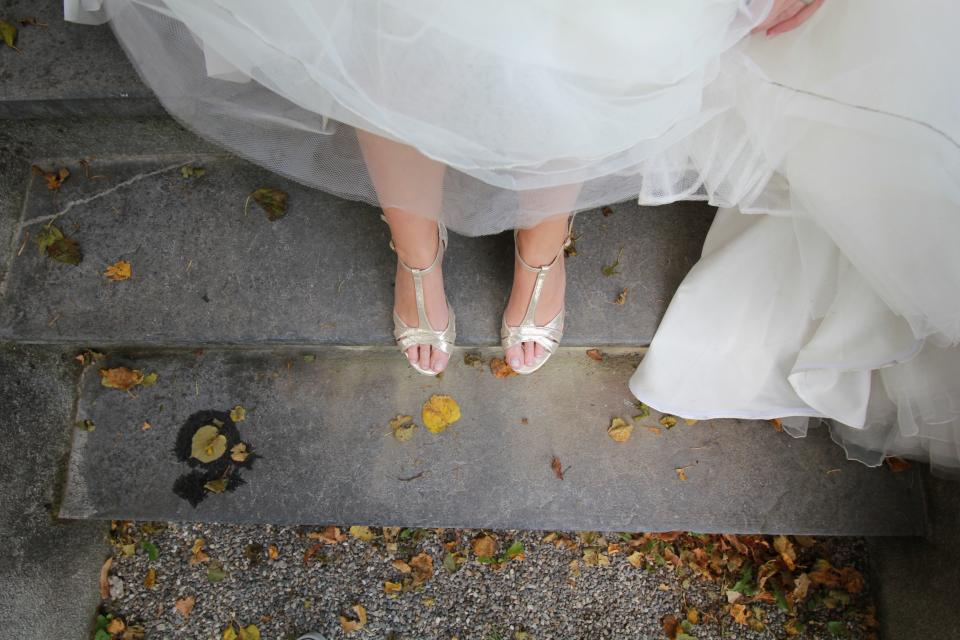 white wedding gown dress leg shoe bride