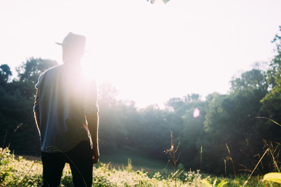 sunshine sun rays guy man hat people forest woods trees nature summer