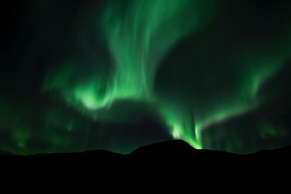 aurora green space sky atmosphere mountain silhouette