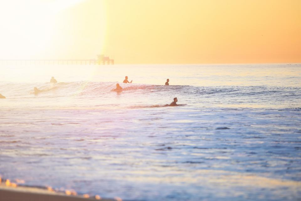 sea ocean water waves nature people swimming sport surfing surfer horizon sky sunset sunrise