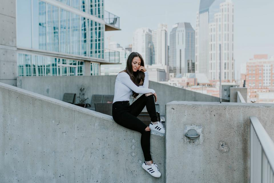 architecture building infrastructure sky wall people girl sitting alone beauty fashion model