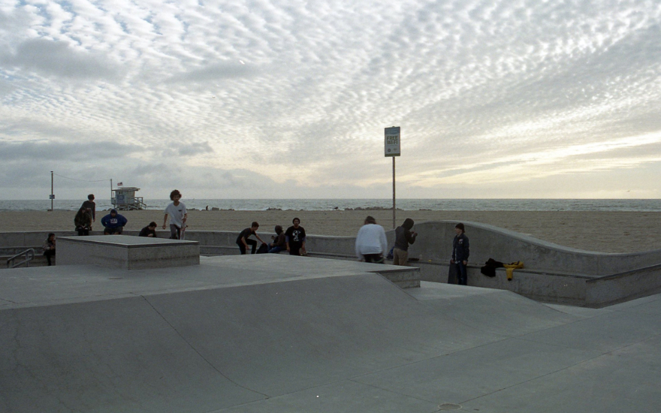 skateboarder venice sport california action activity concrete outdoors park coast beach people vintage sky clouds horizon