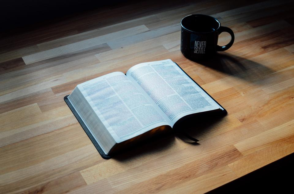 book bible old paper pages testament religion sheet verses chapters bookmark table wood cup mug