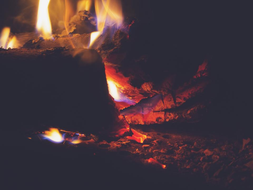 fire fireplace flames wood logs