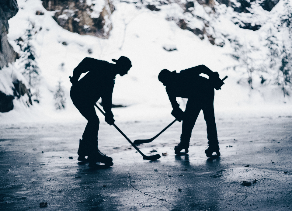 sports hockey ice hockey snow face off puck hockey stick ice winter cold people skating puck silhouette