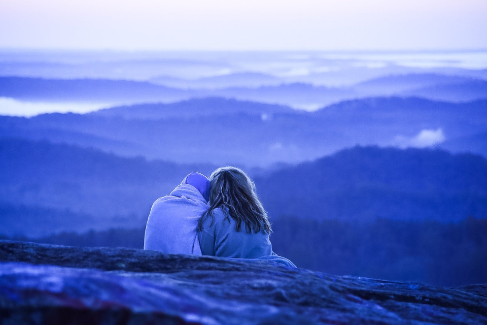 couple mountain view scenic people blue landscape nature outdoors hiking sitting peaceful enjoyment travel explore altitude
