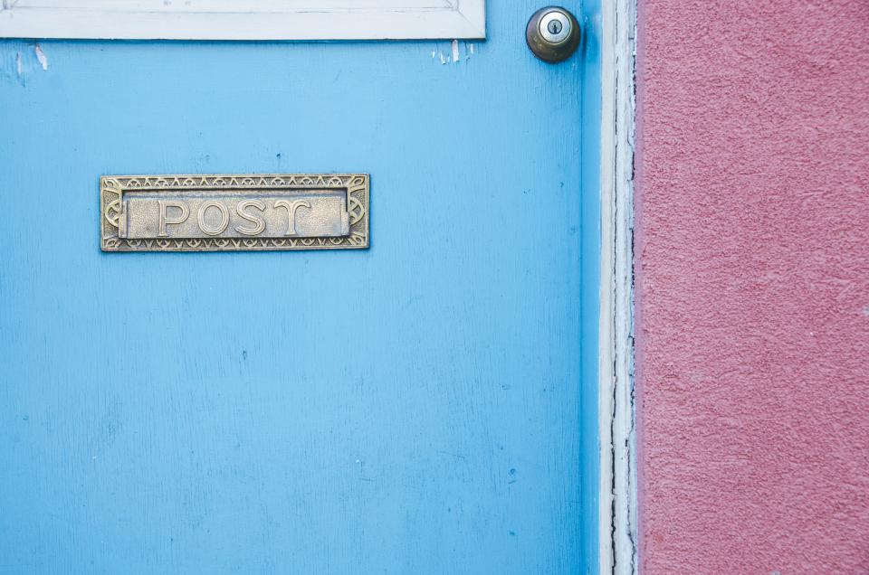 architecture establishment apartment blue pink door house home mail post