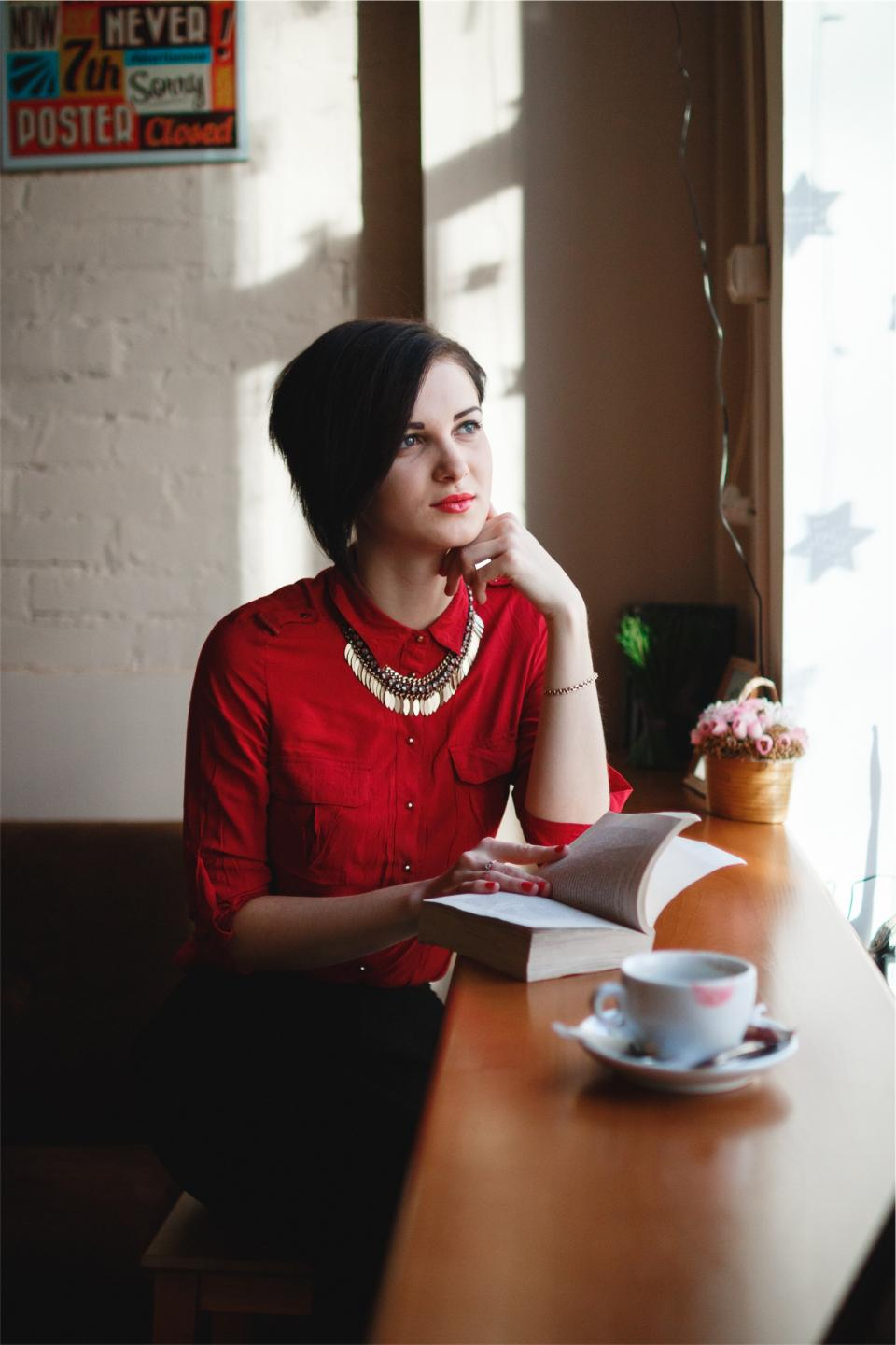 book reading girl woman pretty beautiful people fashion cafe coffee cup red shirt makeup thinking looking
