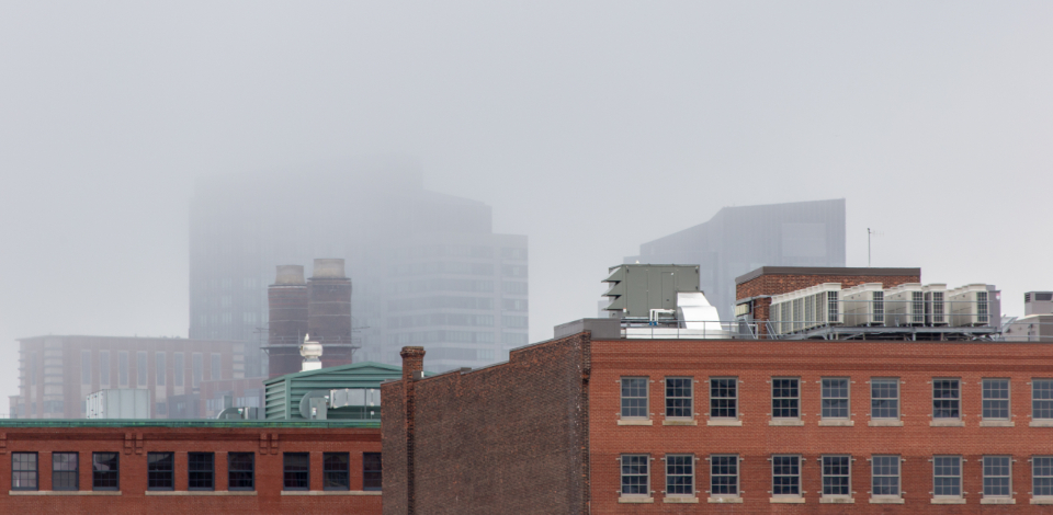 city fog buildings mist brick weather climate air cloudy urban windows industrial old rooftop architecture
