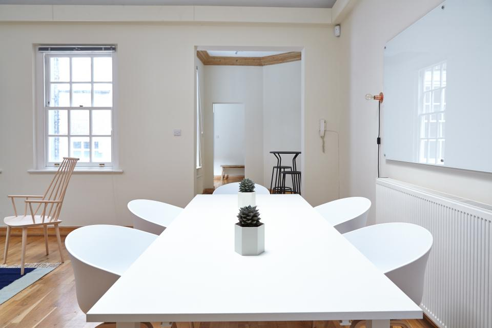 interior design tables chairs white wall board meeting room office door window