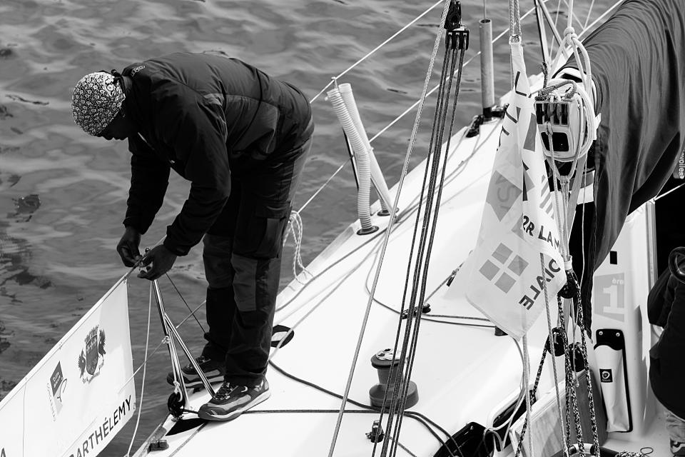 people man boat yacht cable fence fishing sailing water sea black and white alone