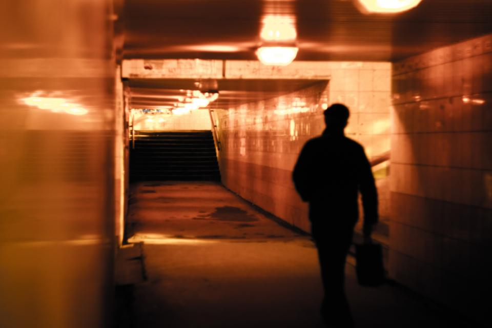 people man alone walking building light alley underground silhouette