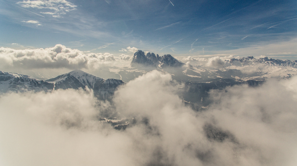 aerial mountain view sky clouds high scenic landscape nature outdoors flying above sunlight