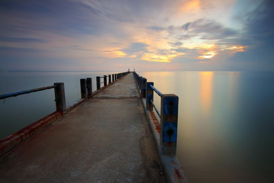 sea ocean water horizon blue sky cloud sunset pier bridge nature travel outdoor
