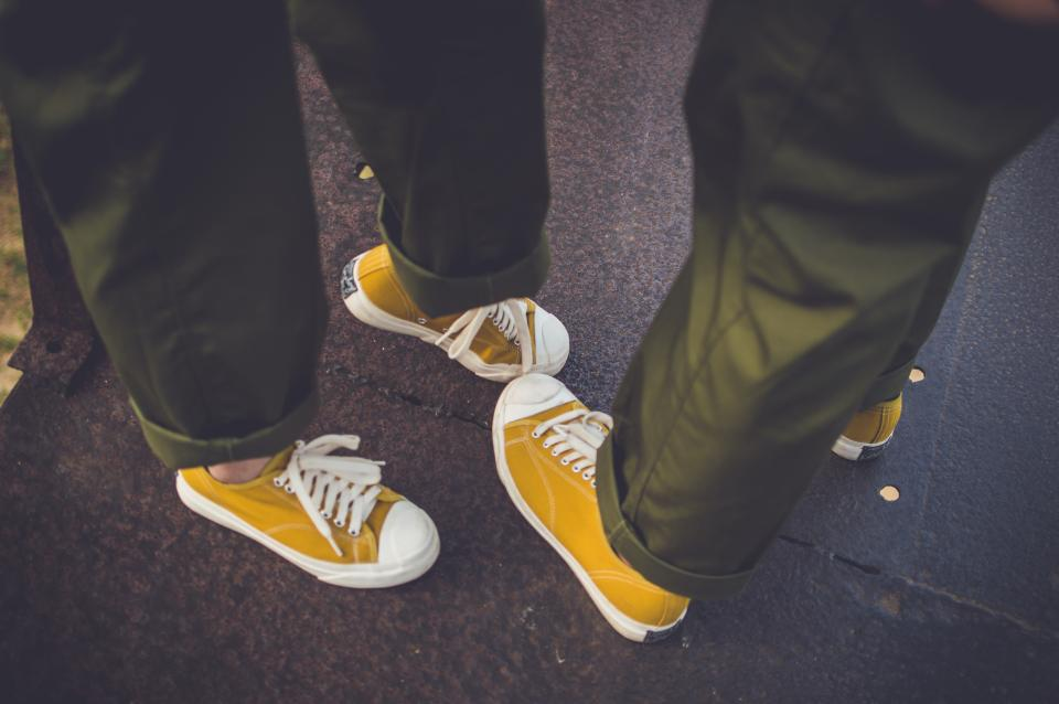yellow shoe footwear pants couple people travel outdoor