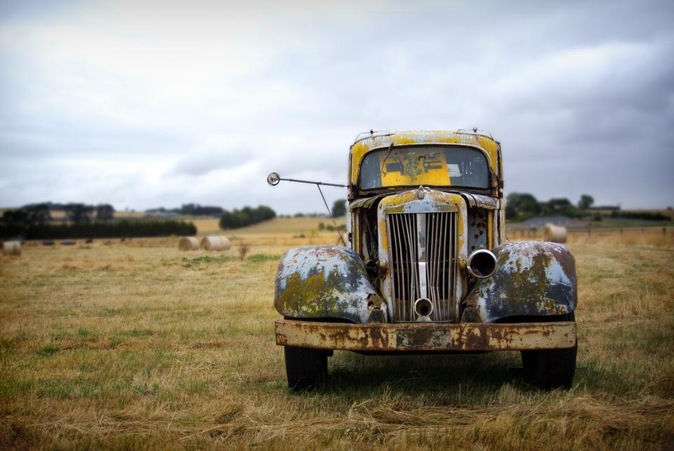 still items things truck old rusty grass bushes sky clouds horizon