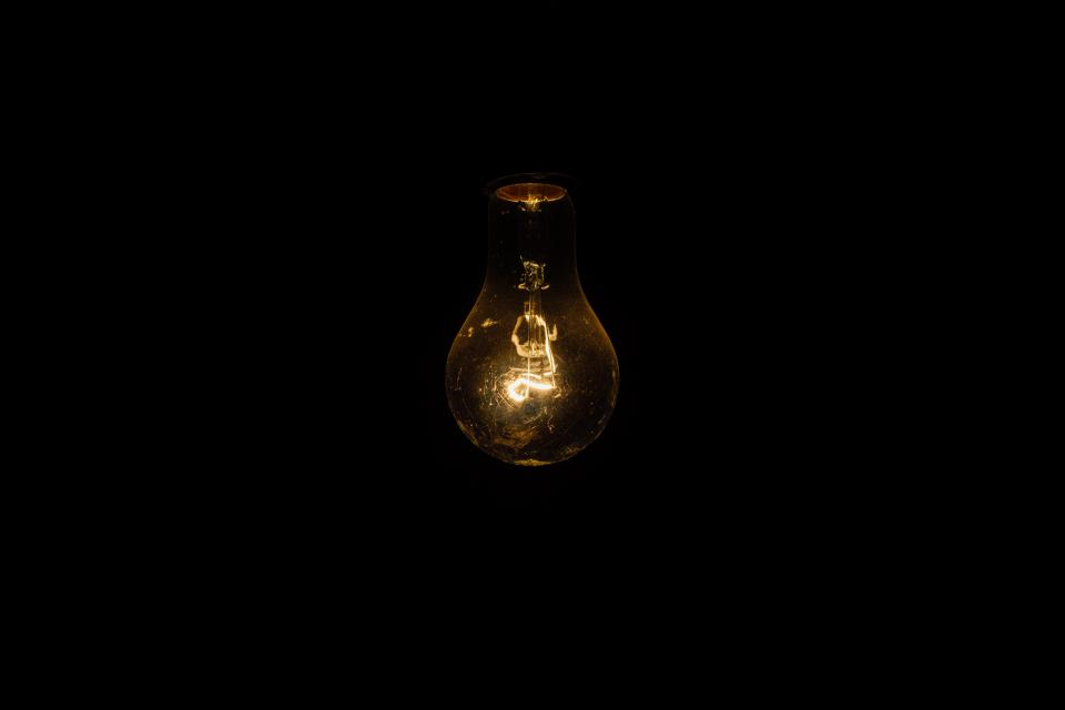 light bulb lights dark night idea