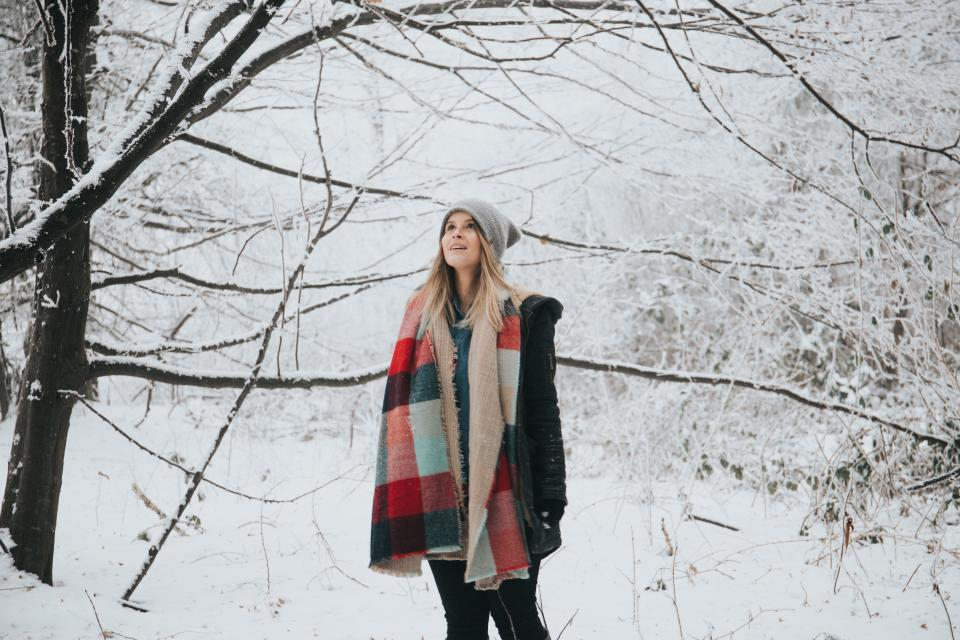 people woman tree branch snow winter travel outdoor