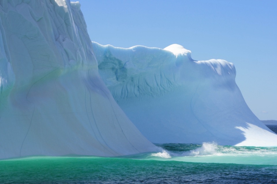 iceberg ocean sea arctic floating ice climate cold water sky frost glacier environment landscape seascape coast science