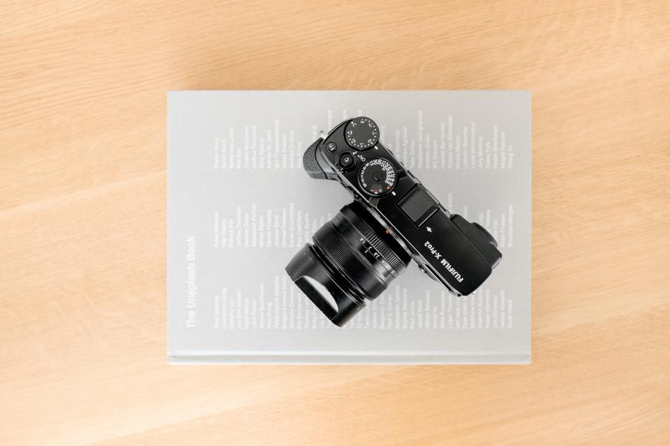camera lens photography table office book business