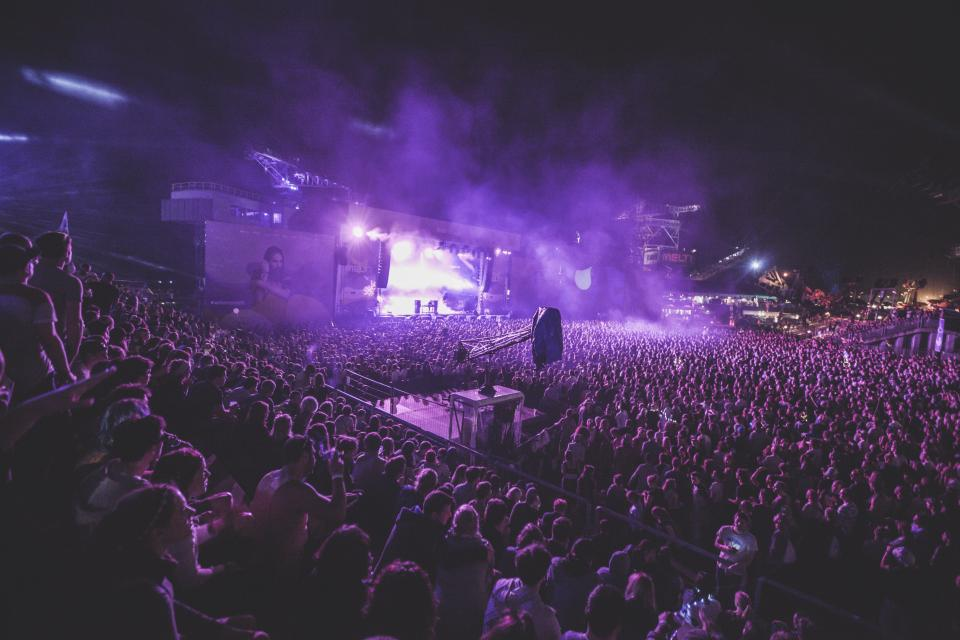 dark night party concert performance stage people man woman audience crowd smoke