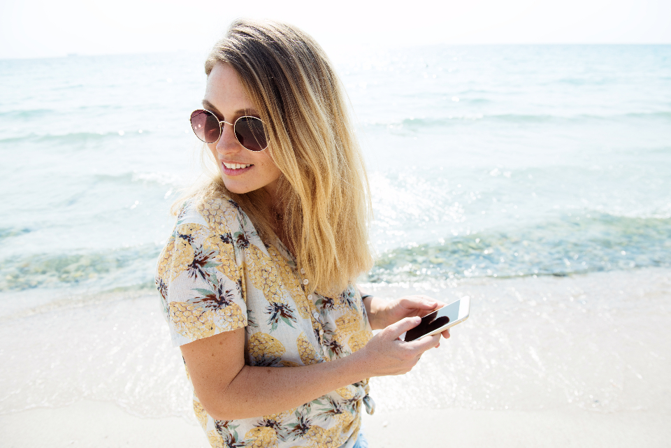 shore freedom tranquil scene ocean beach travel recreation girl nature woman mobile phone smiling connection peaceful recess sea leisure tourism chill sunglasses young holiday vacation traveling serene outdoors peace su