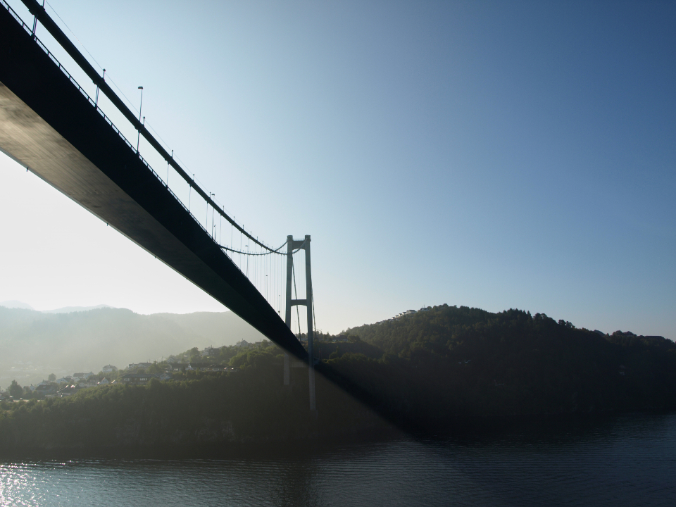 city suspension bridge lake water architecture misty sunrise fog coast bay engineering design travel road mountain sky