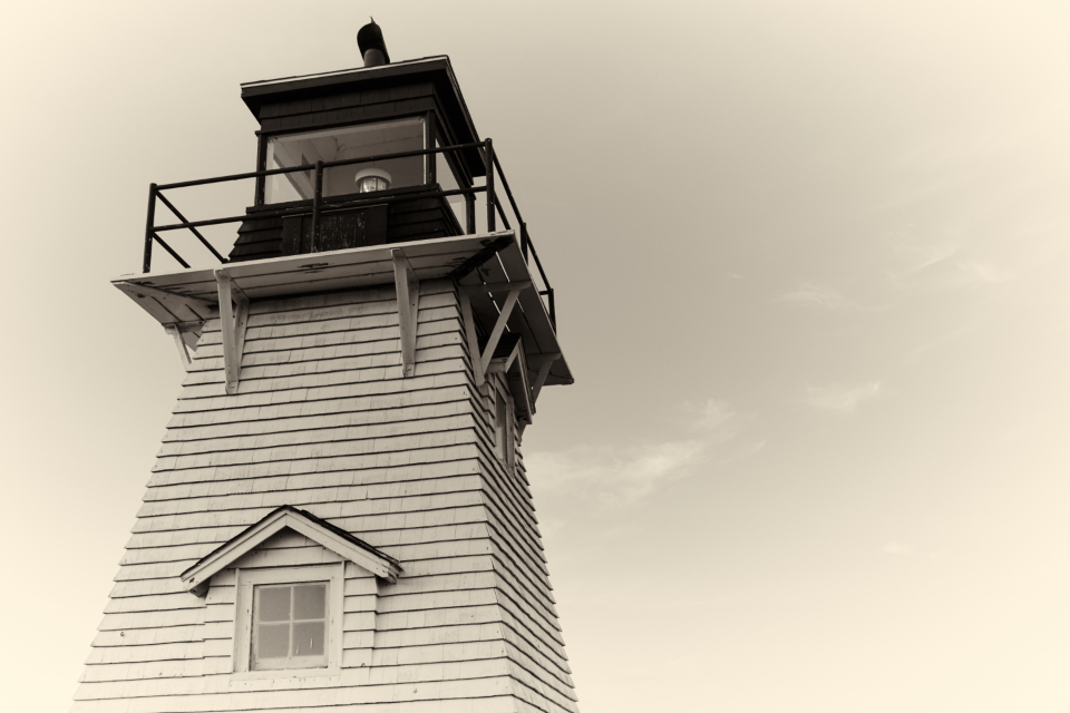 lighthouse sky architecture coast island landmark light building scenic historic weather window close up vintage sepia old