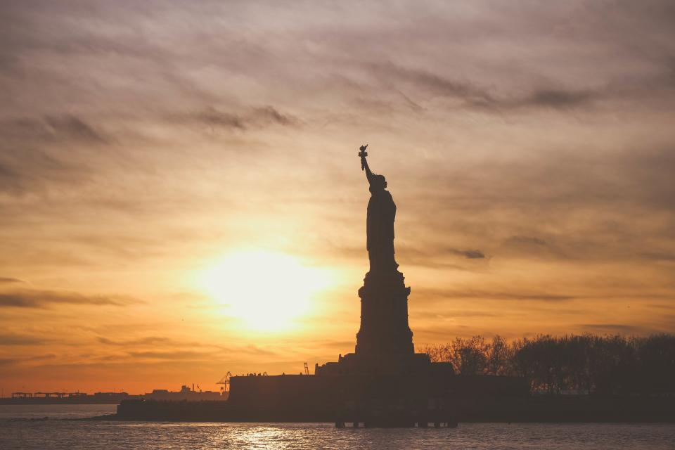 Statue of Liberty shadow silhouette sunset dusk sky clouds water nature landscape
