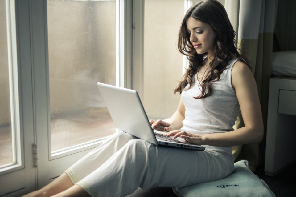 woman laptop work pyjamas window typing computer technology people girl female