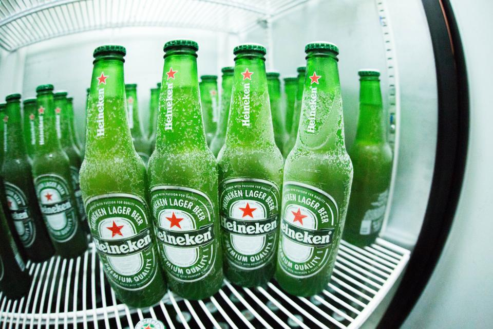 bottles fridge green drinks beverages cold glass refrigerator alcohol beer