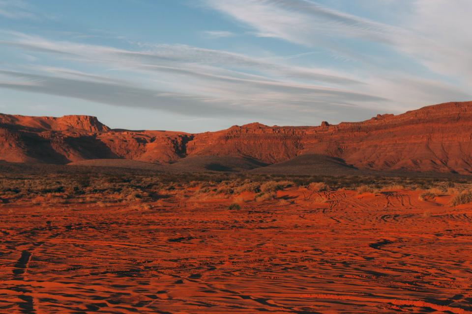 nature landscape canyon rocks red soil land sky clouds horizon
