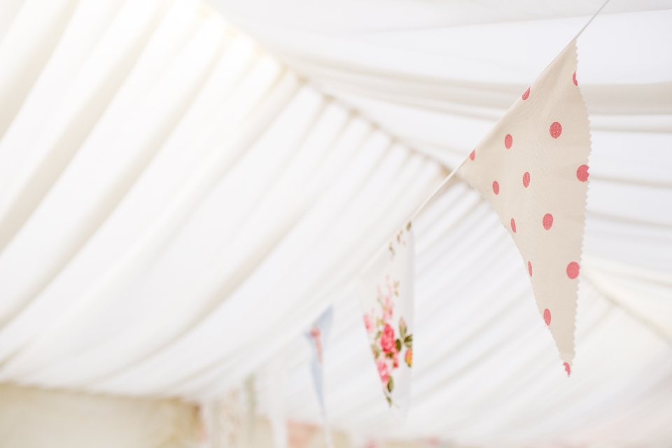 bunting celebration weeding happy ceremony reception pink dots white text gazebo party