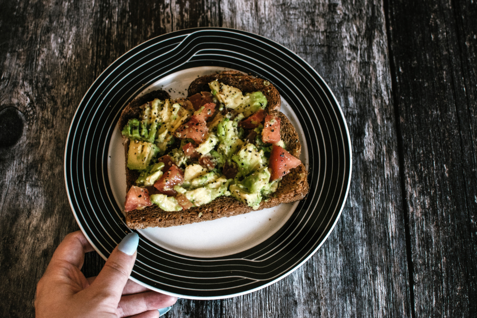 avocado toast snack healthy goodness food dinner meal plate wood table bread fruit