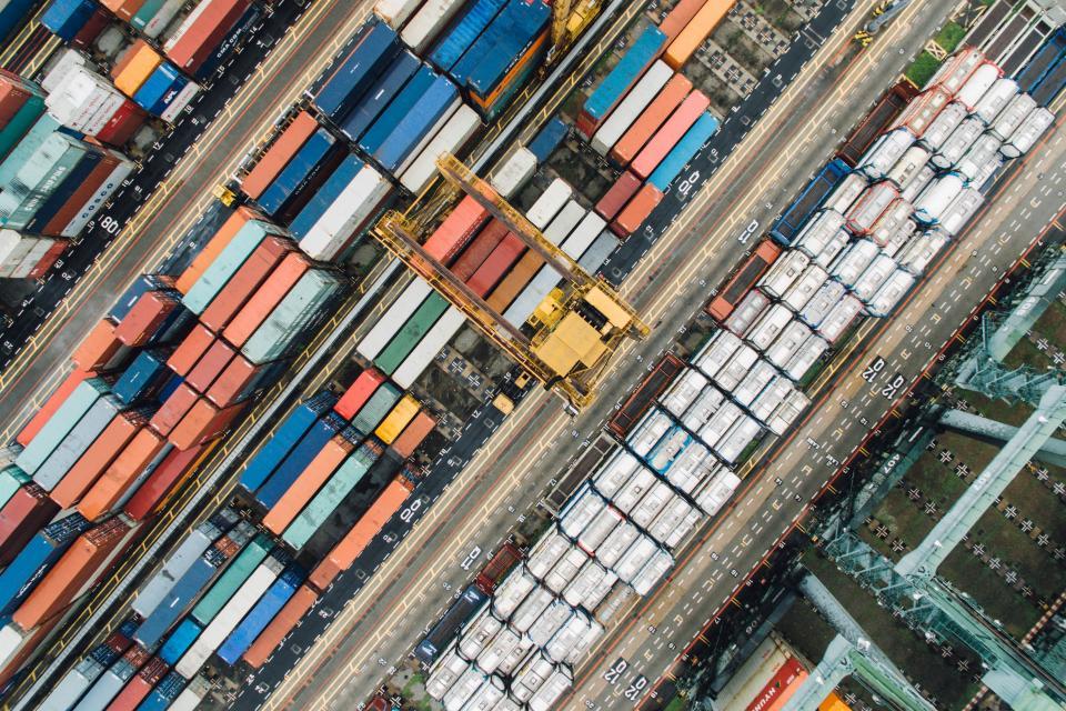 container van export travel cargo wharf block transportation architecture aerial view