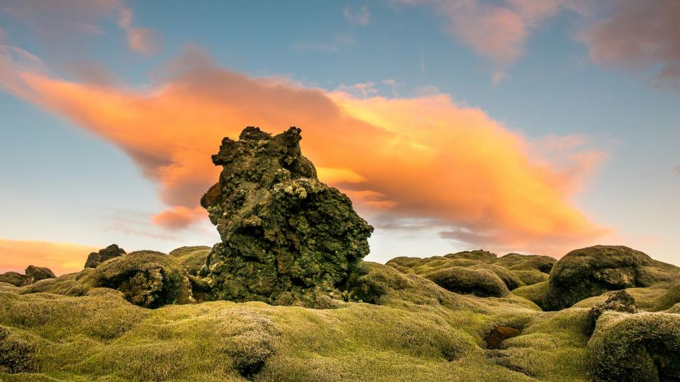 cloud sky sunset rock formation green grass landscape view