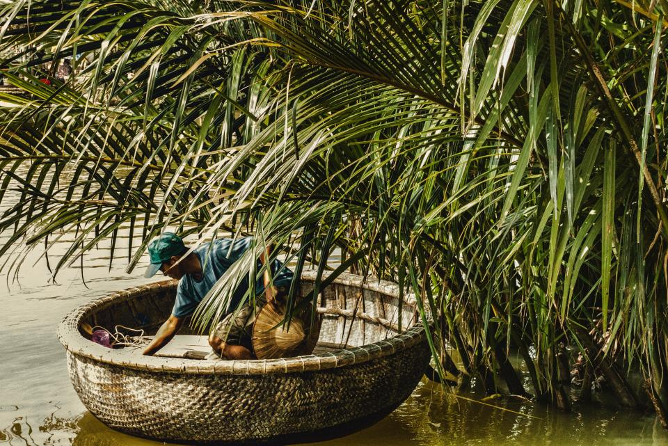 green plants nature people man boat river water vietnam outdoor