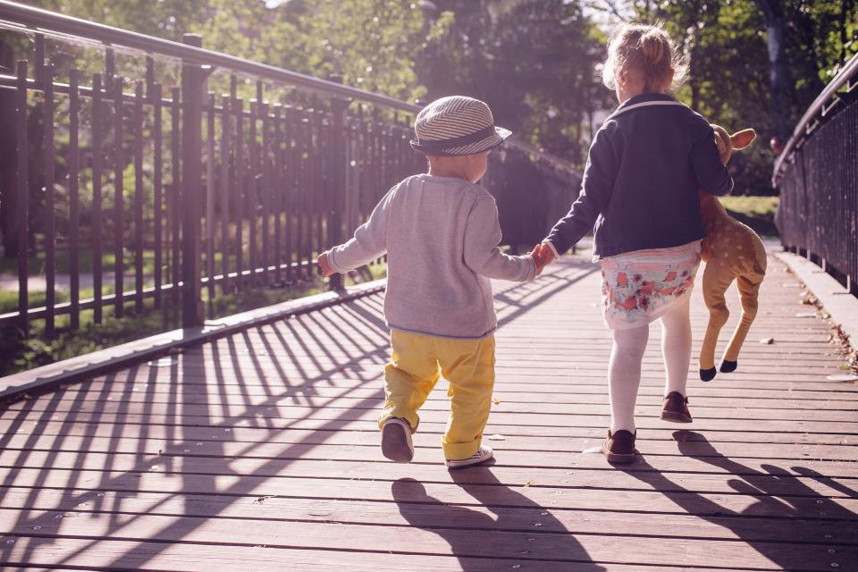 people kids child girl boy baby sunny day playing path bridge toy holding hand shadow