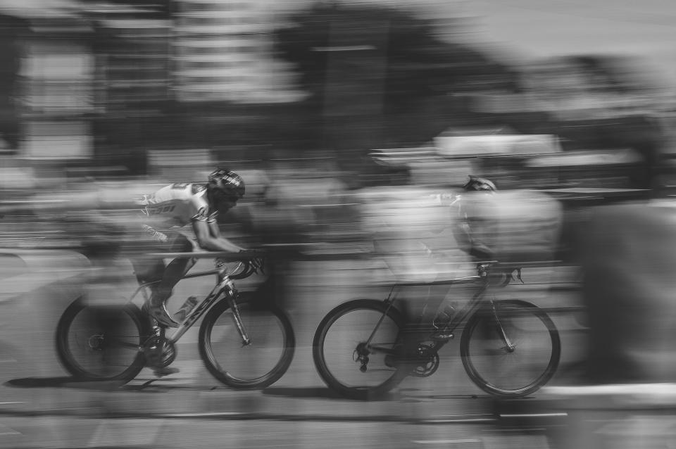 motion people man bicycle bike sport hobby travel blur black and white monochrome