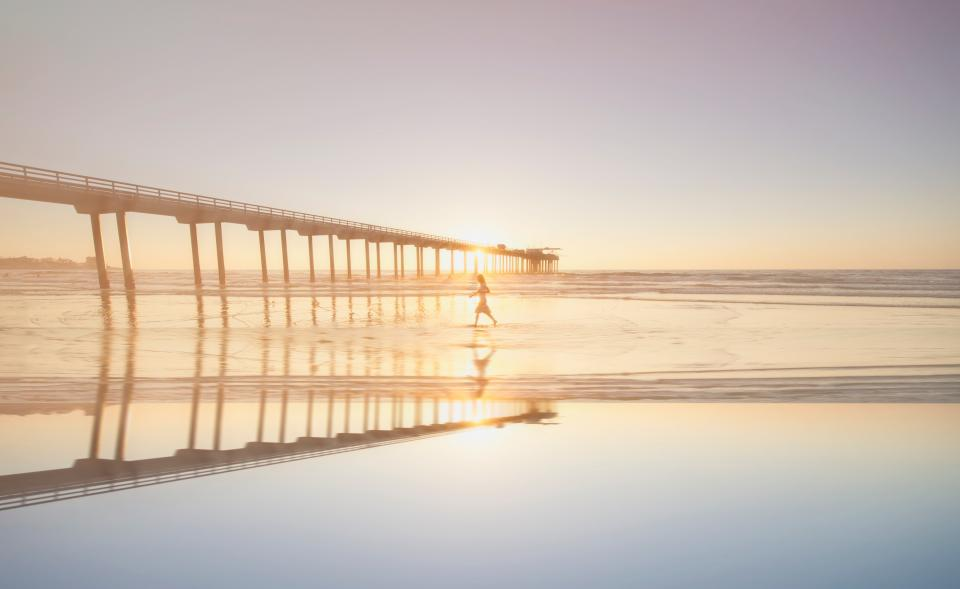 sun sunny sunrise sunset water bridge sea shore sand ocean people child reflection summer