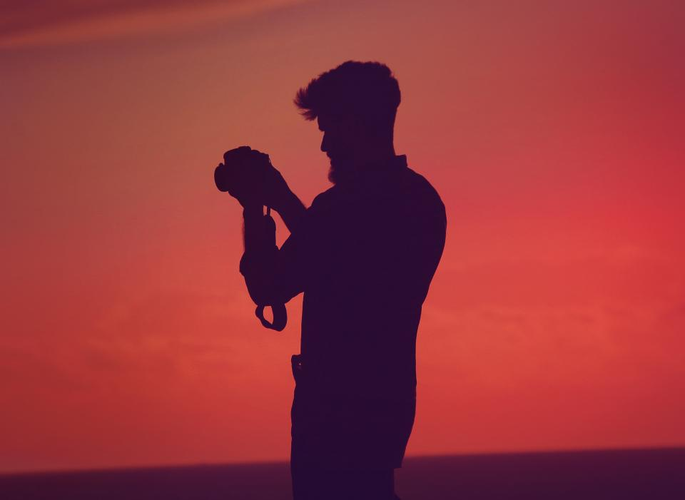 people man silhouette shadow camera photographer orange sunset shutter iso aperture
