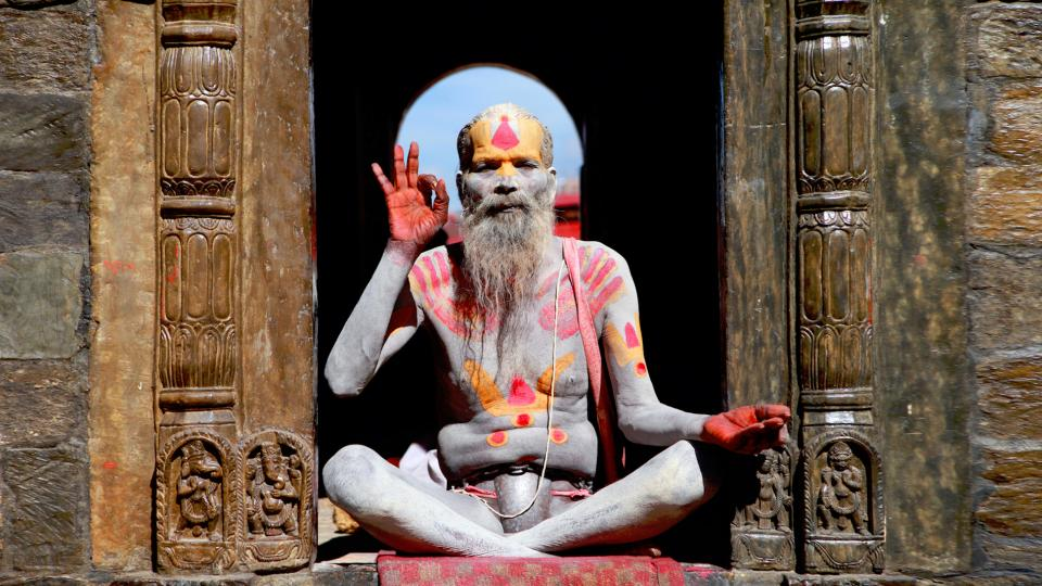 places temple people old man guy meditation red orange paint