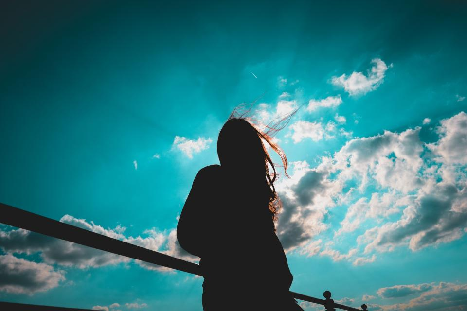 people woman girl standing alone clouds sky silhouette outdoor sunlight