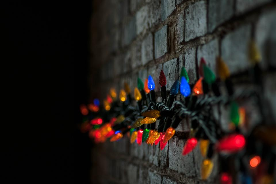 dark wall colorful lights wire